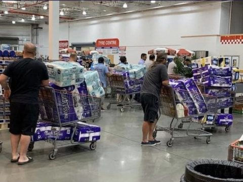 Photo of shoppers at warehouse store hoarding for 2020 COID-19 pandemic.